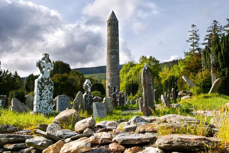 Round tower and semetery in Glendalough royalty free stock images