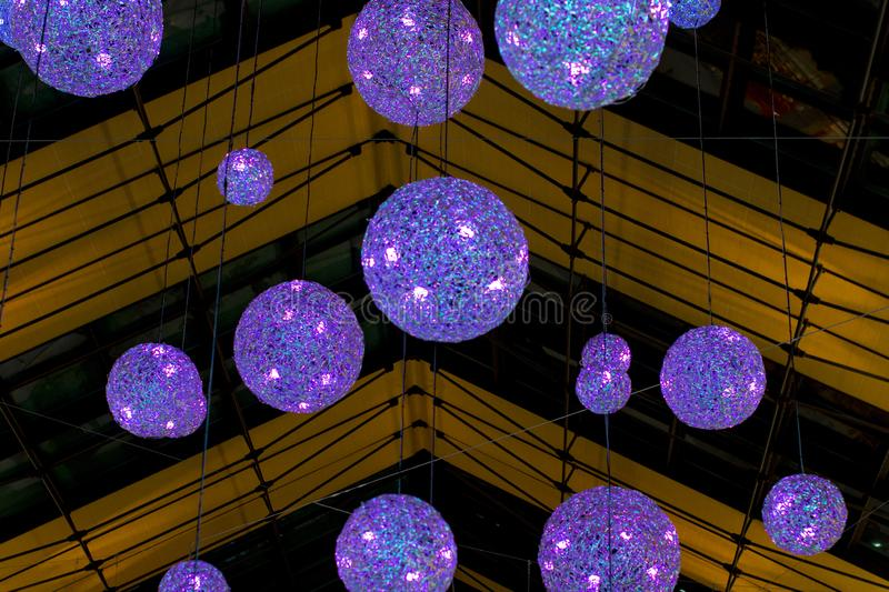 Round transparent ball hanging on the ceiling. New year and Christmas holiday royalty free stock photos