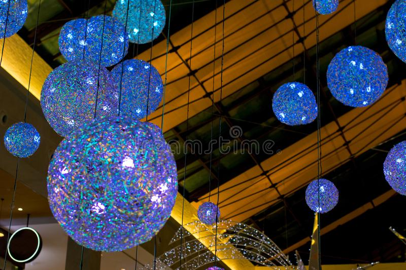Round transparent ball hanging on the ceiling. New year and Christmas holiday royalty free stock images