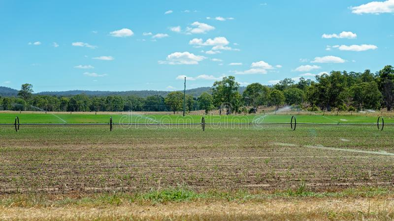 Round Traveling Irrigation System Watering A Crop royalty free stock photo