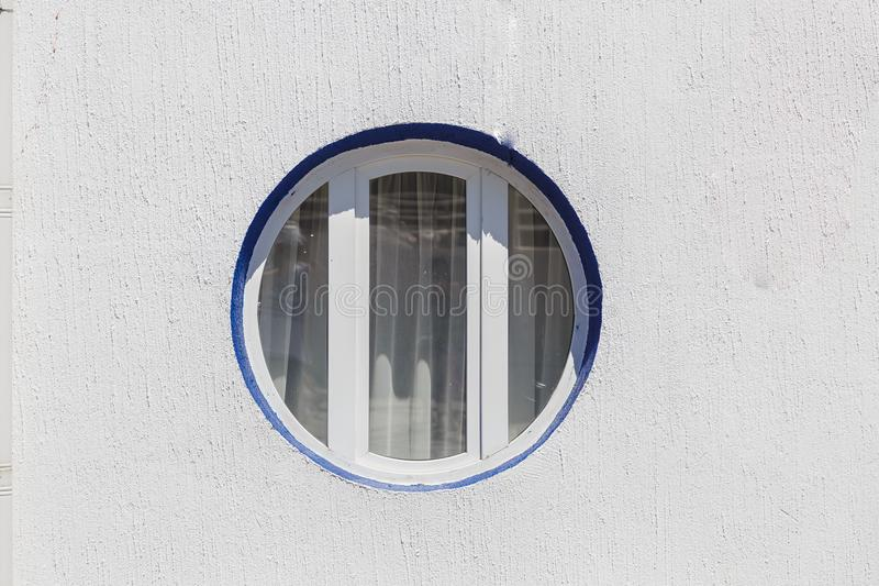 Round and vintage shape of glass window on a brick wall building digital composite with moon. Moon Globe shape courtesy. Of NASA stock photography