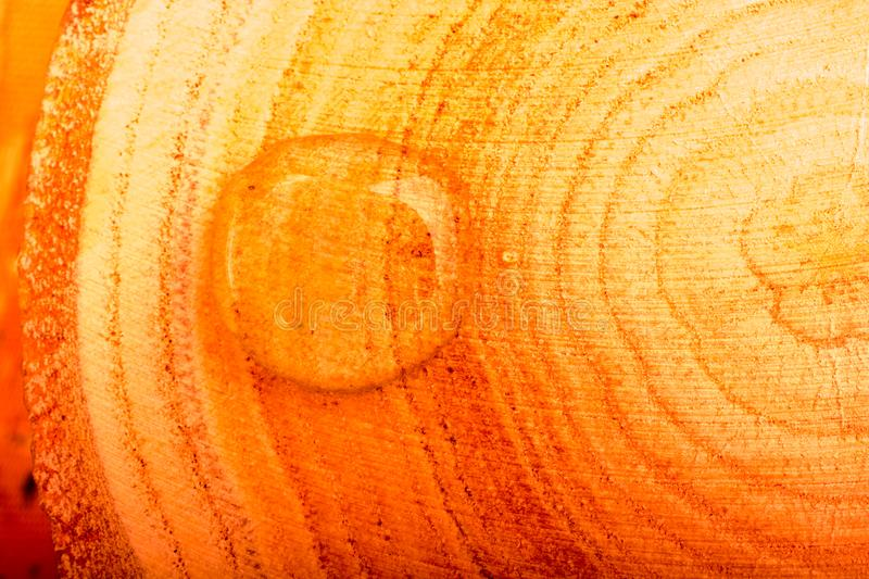 Round water drops in close-up on wooden background stock image