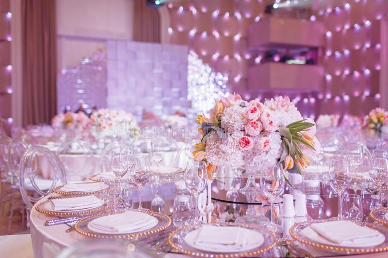 A round wedding table in the pink hall royalty free stock image