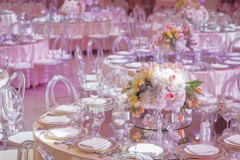 A round wedding table in the pink hall stock image