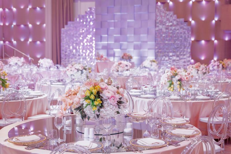 A round wedding table in the pink hall stock photo
