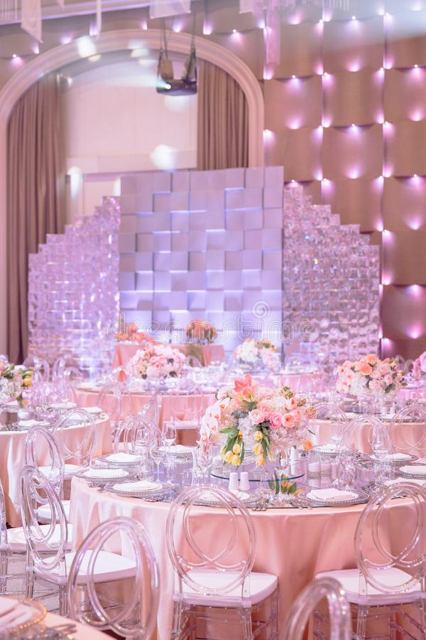 A round wedding table on the wedding hall stock image