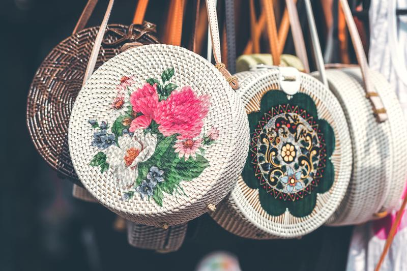 Round White and Pink Floral Woven Sling Bags royalty free stock photography