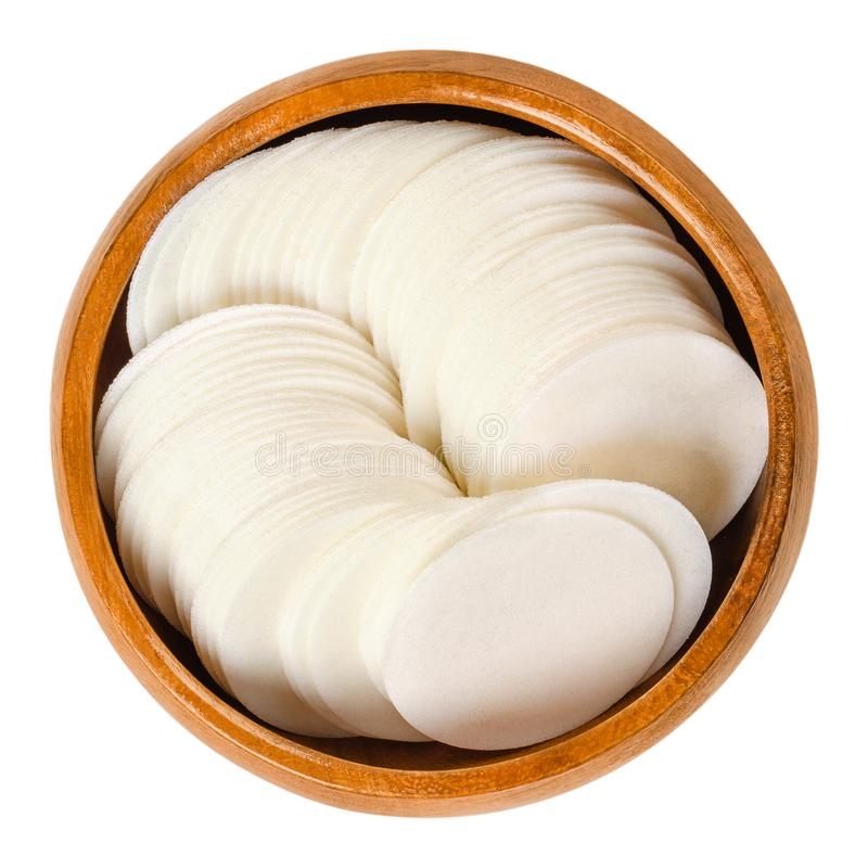 Round white wafer papers for baking in wooden bowl royalty free stock photo