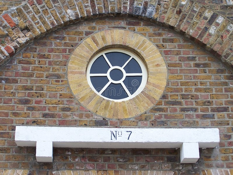 Round window detail and plinth stock photos