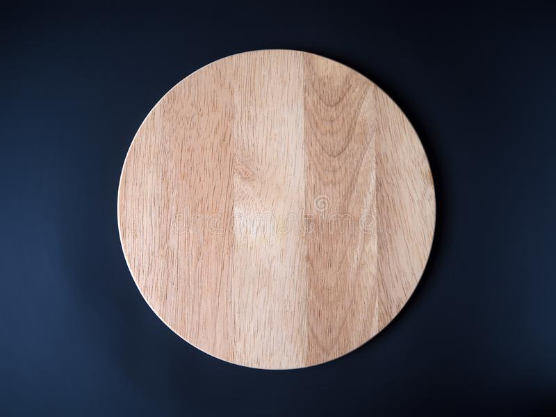 Empty round wooden cutting board stock photography