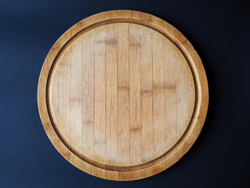 Round wooden cutting board royalty free stock photos