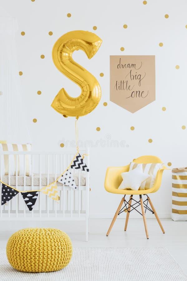 Yellow pouf on carpet stock photo