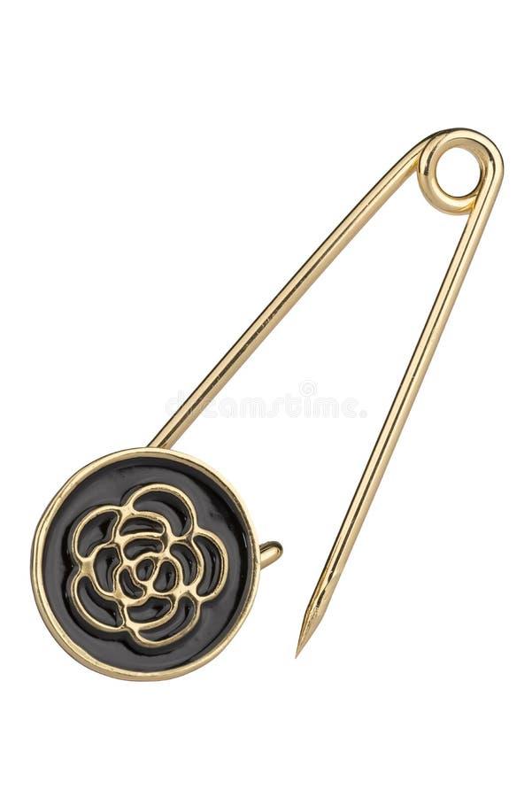 Round złota broszka z szpilką, odosobnioną na białym tle, ścinek ścieżka zawierać fotografia royalty free