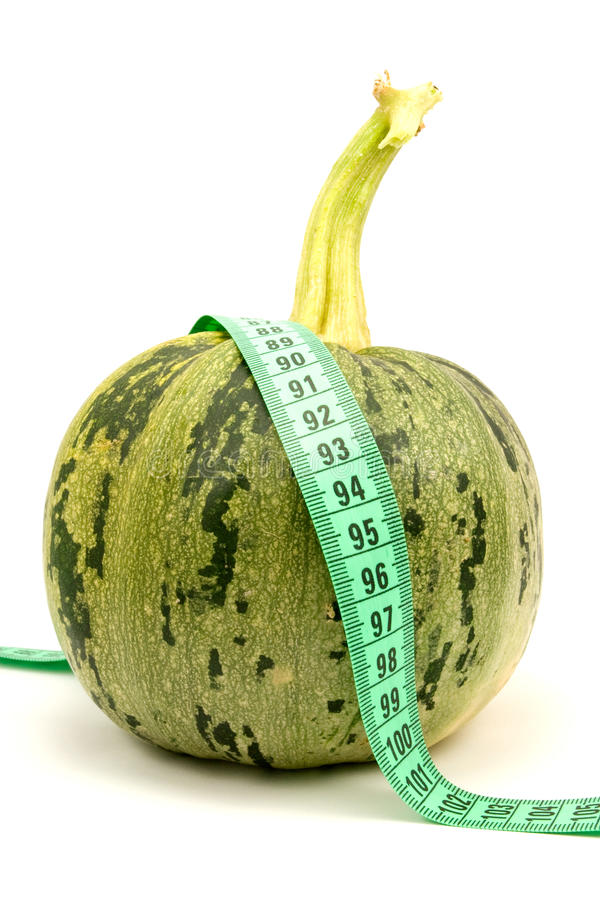 Round Zucchini With Measuring Tape Royalty Free Stock Photo