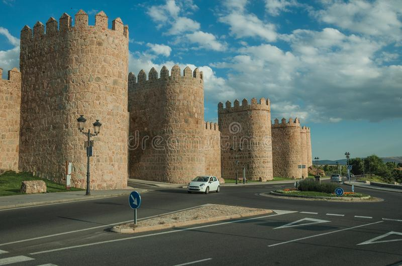 Roundabout in front gateway and large wall encircling Avila royalty free stock image