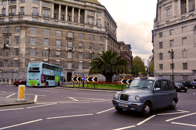 Roundabout near Lambeth Bridge and Millbank London, United Kingdom. Lambeth Bridge is a road traffic and footbridge crossing the River Thames in an east-west royalty free stock photo