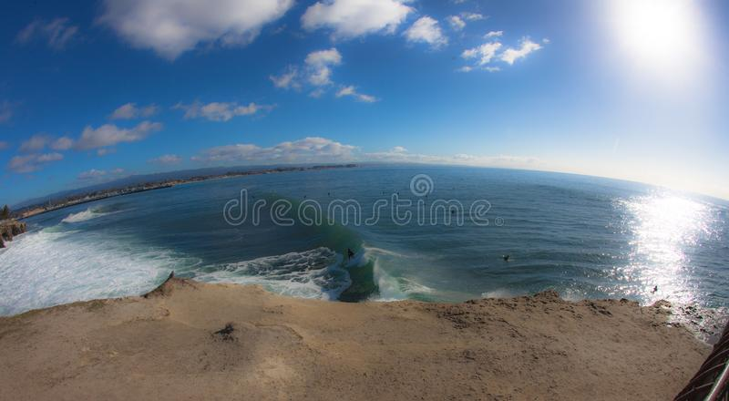 The rounded bay of santa cruz with a fish eye lens while the sun. Santa Cruz, United States - January 27 , 2013 :  the sun is reflection on the pacific while stock images