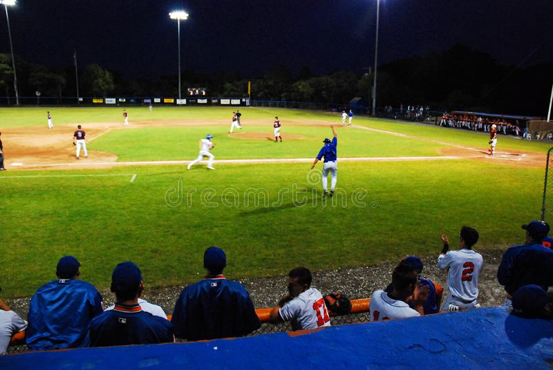 Rounding Third, and Headed for Home in the Cape Cod Baseball League. A base runner rounds third, and Heads for Home in the Cape Cod Baseball League royalty free stock photo