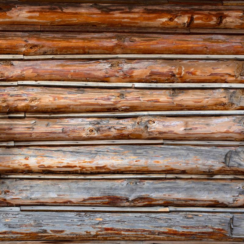 Roundish Rustic Log Wall Horizontal Timber Background. Natural texture part facade of a log wall of cabin or house. Roundish Rustic Log Wall Horizontal Timber royalty free stock photos