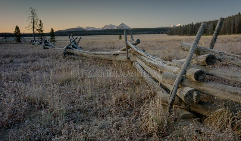 Wood pole fence and Sawtooth mountains on a frosty morning royalty free stock photography