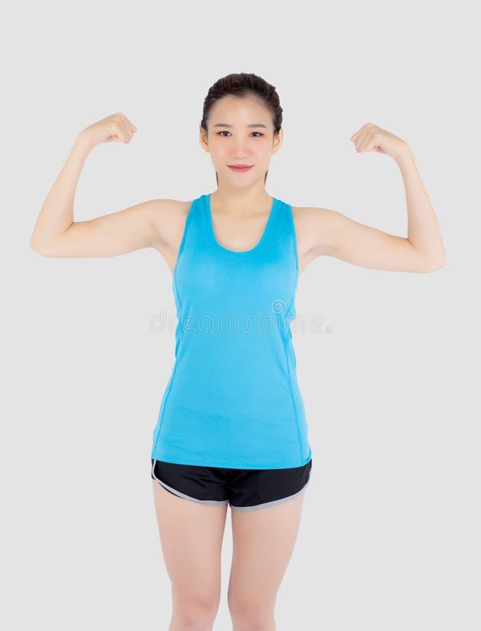 A roupa asiática nova do esporte do desgaste de mulher do retrato bonito tem forte e o músculo com saúde, bíceps da mostra da men foto de stock royalty free