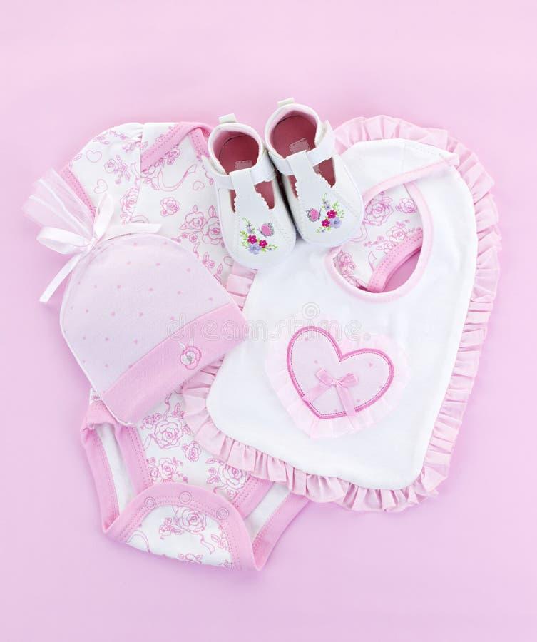 Roupa cor-de-rosa do bebê para a menina infantil fotos de stock