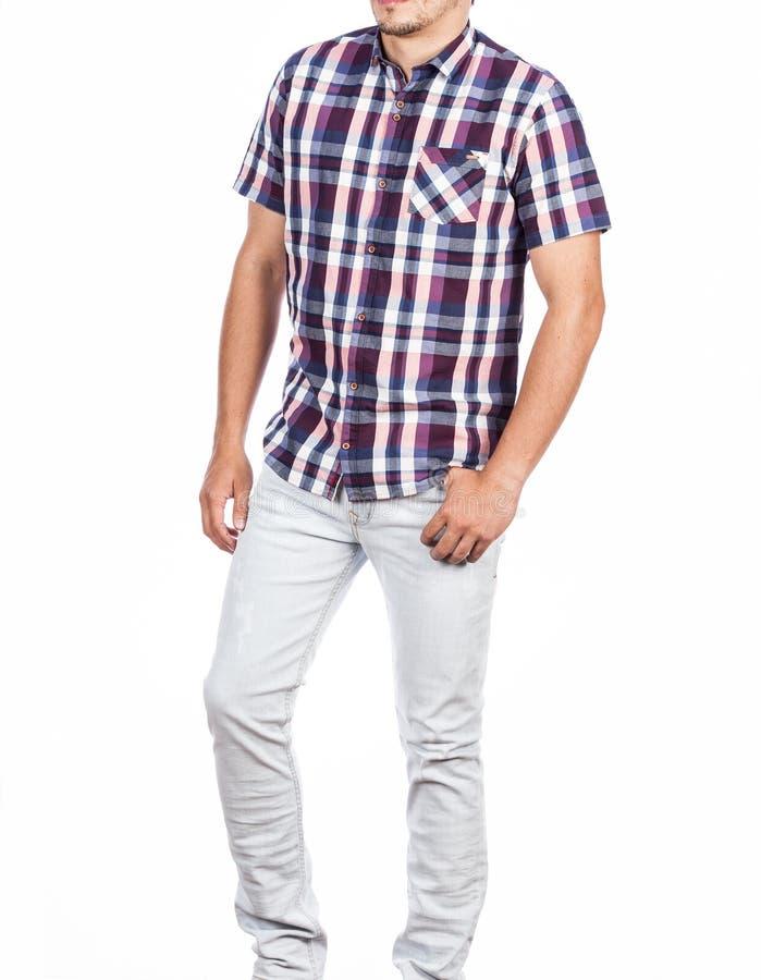Roupa da forma, camisa curto da luva e foto dos homens das cal?as no fundo branco fotografia de stock