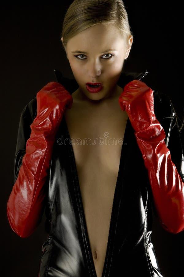 Roupa desgastando do látex da mulher imagem de stock