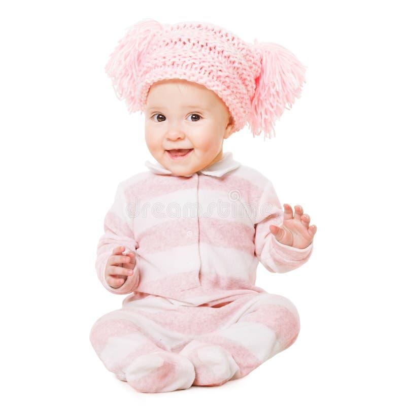 Roupa do bebê, criança feliz no chapéu cor-de-rosa, assento da criança imagens de stock royalty free