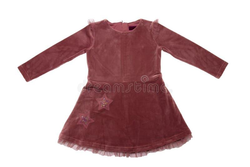 Roupa para crianças Um vestido marrom bonito de veludo com laço para a menina isolada em um fundo branco Forma das crianças fotos de stock