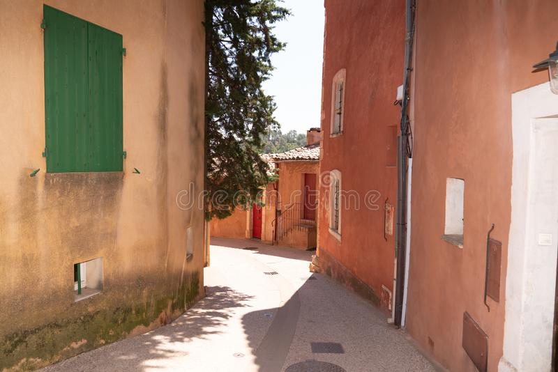 Roussillon beautiful French village alley colorful locally mined ochre  france. A Roussillon beautiful French village alley colorful locally mined ochre  france royalty free stock photo