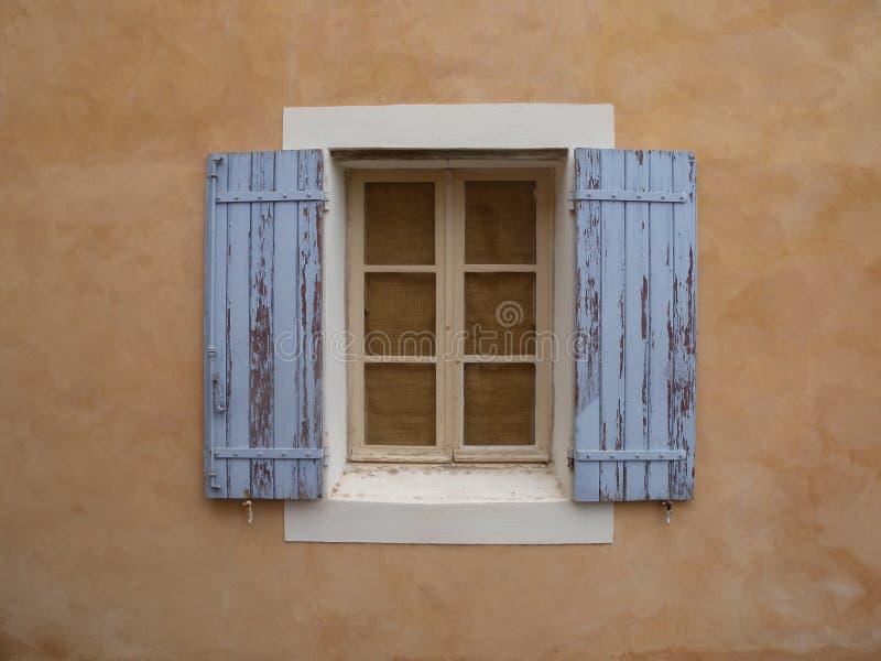 Roussillon hill village rustic window blue  ocher Provence France stock photo