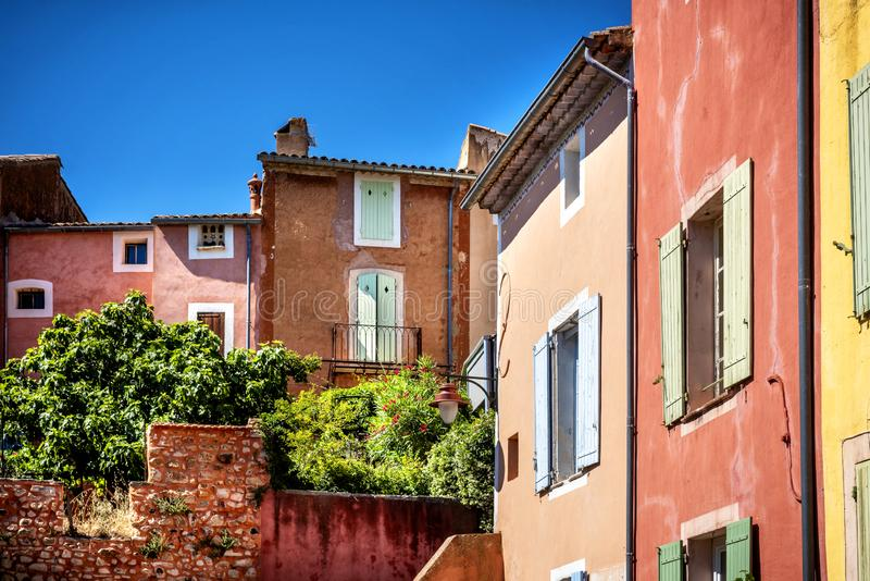 Roussillon: A narrow street in the beautiful French village of Roussillon, where the buildings are made with colorful, France royalty free stock images
