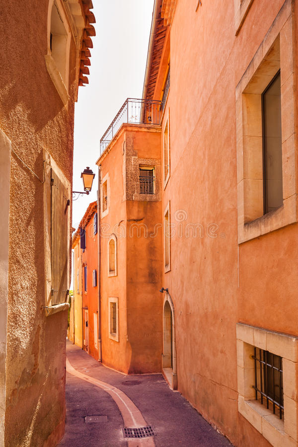 Roussillon village, urban street and red facades . Luberon, Provence, royalty free stock photography