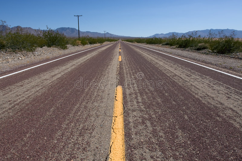Route 66. Old route 66 at daytime with green bush stock image