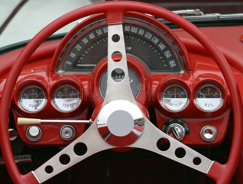 Route 66 Revisited. Corvette dashboard red stock photo
