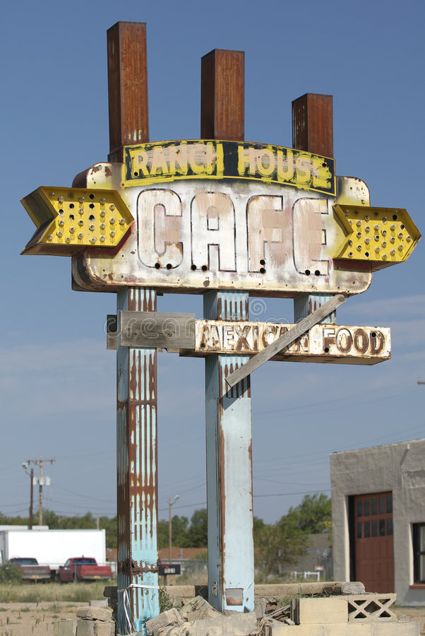 Route 66 Roadside Sign. A Route 66, New Mexico road sign advertising the long closed Ranch House Cafe stock photo