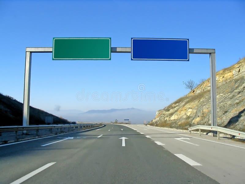 Route avec des signes photographie stock