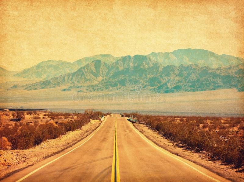 Route 66 crossing the Mojave Desert, California, United States.  Photo in retro style. Added paper texture. Toned image.  royalty free stock image
