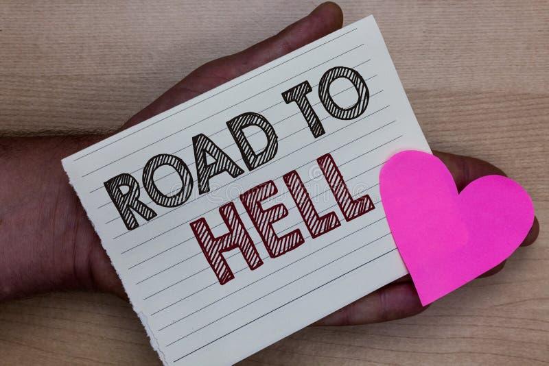 Route des textes d'écriture de Word à l'enfer Concept d'affaires pour l'homme peu sûr risqué foncé de voyage de passage extrêmeme images libres de droits