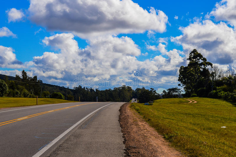 Route. Excerpt from Route 9 in Uruguay, surrounded by trees and vegetation showing blue sky with clouds royalty free stock photos