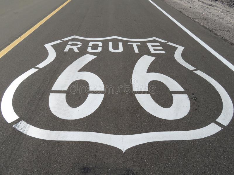 Route 66 Logo Printed on the Mother Road in California. Route 66 road sign printed on the asphalt of Mother Road in California near the Mojave Desert royalty free stock images