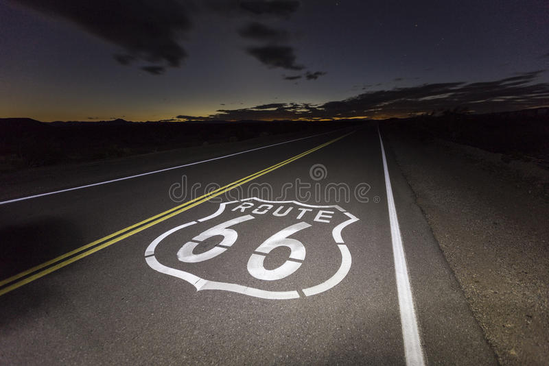 Route 66 Mojave Desert Night. Route 66 pavement sign in the California Mojave desert night stock images