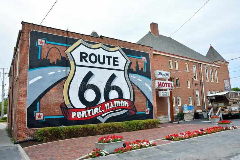 Route 66 mural in Pontiac, Illinois. PONTIAC, IL-USA - JULY 16: Route 66 mural commemorates the city`s role on July 16, 2017, in Pontiac, Illinois. Created by stock photo