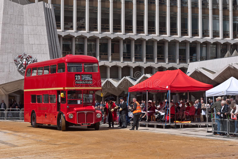 A Routemaster bus in the Cart marking Ceremony. A 1962 Routemaster bus is marked with a year brand and then parades in front of dignitaries and visitors , in the royalty free stock images