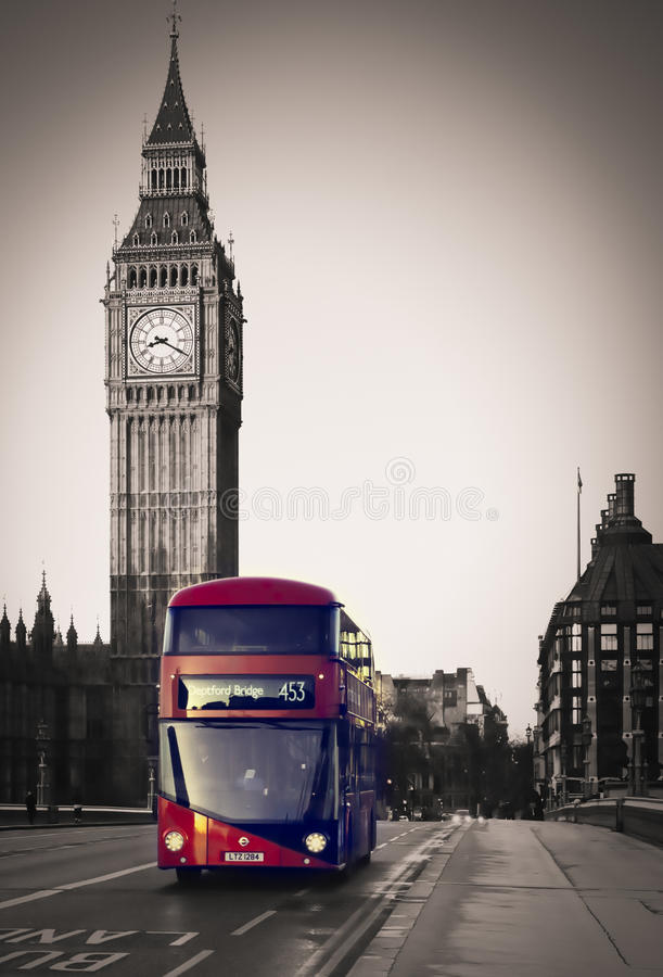Routemaster bus on Westminster Bridge. A new Routemaster double decker bus on the Westminster Bridge with the Elizabeth tower in the background royalty free stock images