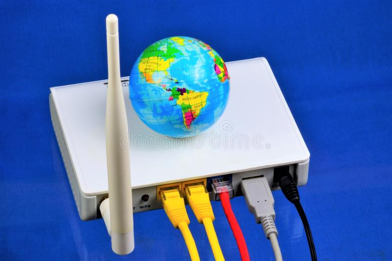 The router - Internet connection, the world wide web. Router — network device for Internet access and for corporate network. Routers built the entire stock photo
