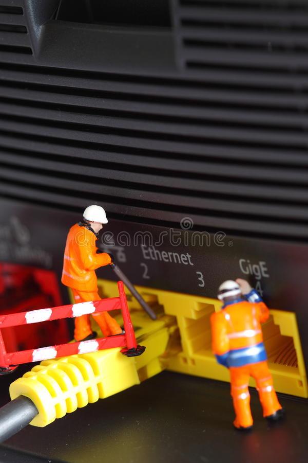 Router miniature model workers A stock photo
