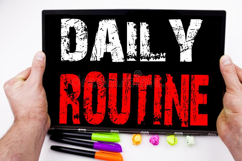 Daily Routine text written on tablet, computer in the office with marker, pen, stationery. Business concept for Accuracy Procedure stock images