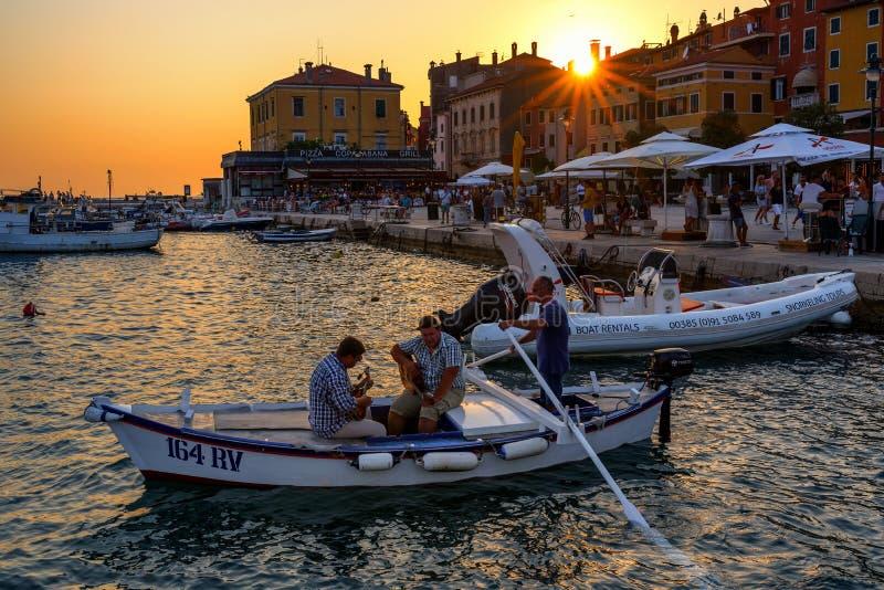 Batana boat parade at sunset in Rovinj, Croatia stock image